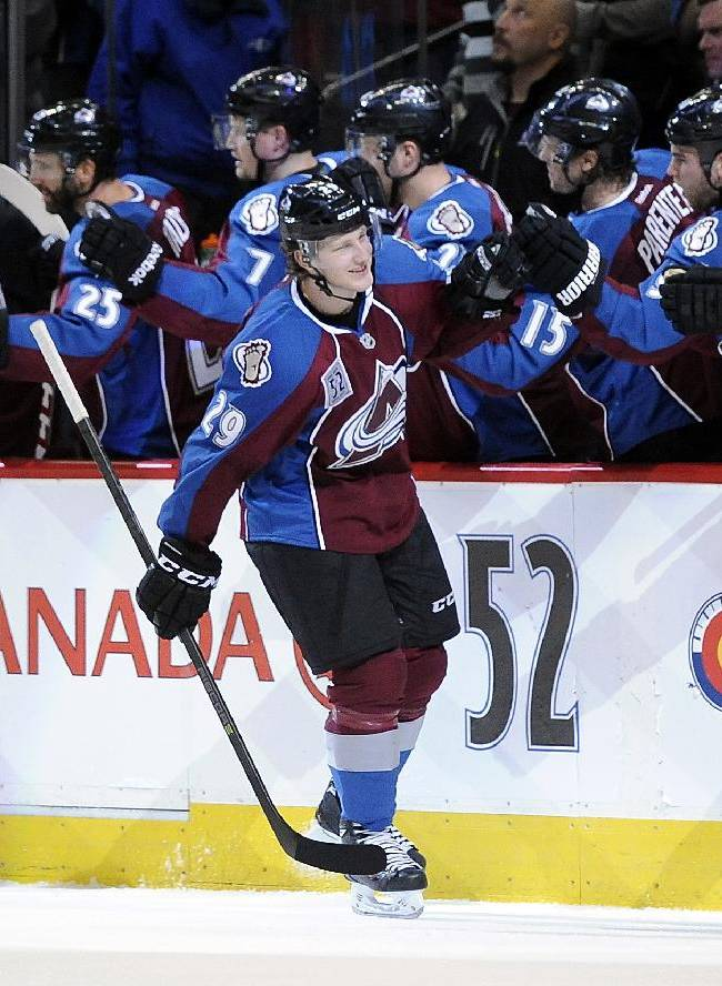 Colorado Avalanche center Nathan MacKinnon celebrates his goal in the third period of an NHL hockey game against the Montreal Canadiens, Saturday, Nov. 2, 2013, in Denver. The Avalanche won 4-1