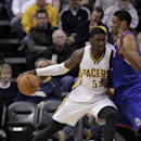 Indiana Pacers center Roy Hibbert, left, leans into Philadelphia 76ers center Daniel Orton during the first half of an NBA basketball game in Indianapolis, Saturday, Nov. 23, 2013 The Associated Press