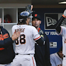San Francisco Giants left fielder Michael Morse gets a pat on the back from manager Bruce Bochy as he is greeted in the dugout following his solo home run against the San Diego Padres in the fifth inning of a baseball game Saturday, April 19, 2014, in San