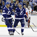 Tampa Bay Lightning center Steven Stamkos (91) celebrates with center Valtteri Filppula (51), of Finland, after scoring against the Ottawa Senators during the third period of an NHL hockey game Monday, March 24, 2014, in Tampa, Fla. The Senators won the g