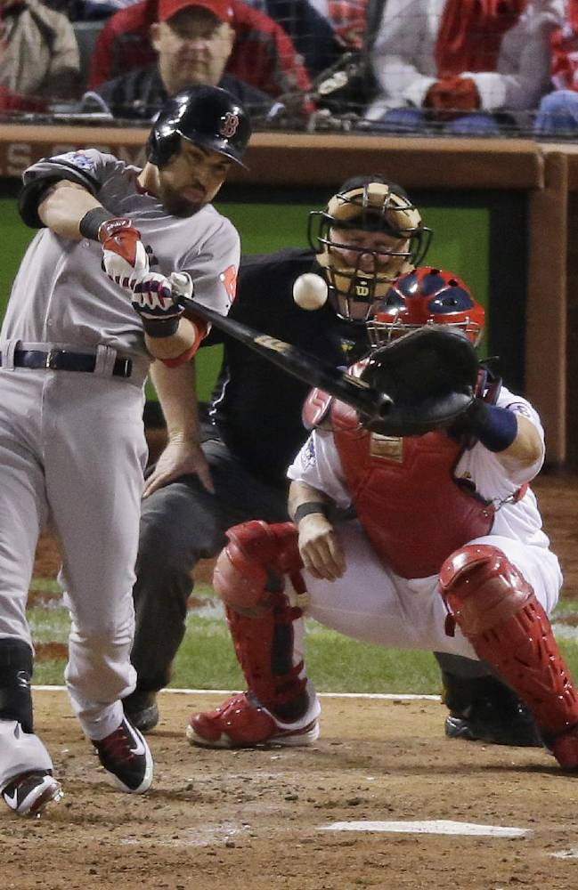Boston Red Sox's Jacoby Ellsbury hits an RBI single during the seventh inning of Game 5 of baseball's World Series against the St. Louis Cardinals Monday, Oct. 28, 2013, in St. Louis