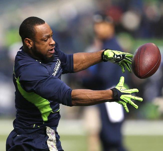 Seattle Seahawks' Percy Harvin reaches for a ball as he warms-up on the field before an NFL football game against the Minnesota Vikings, Sunday, Nov. 17, 2013, in Seattle