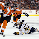 Philadelphia Flyers' Jakub Voracek, left, takes the puck away from a falling Buffalo Sabres' Tyler Ennis, right, during the third period of an NHL hockey game, Sunday, April 6, 2014, in Philadelphia. The Flyers won 5-2 The Associated Press