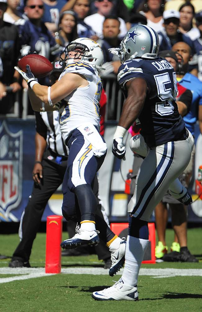 San Diego Chargers running back Danny Woodhead, left, catches a touch down pass in front on Dallas Cowboys outside linebacker Bruce Carter during the first half of an NFL football game Sunday, Sept. 29, 2013, in San Diego