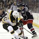 Columbus Blue Jackets' Matt Calvert, right, tries to carry the puck past Boston Bruins' Kevan Miller during the second period of an NHL hockey game Saturday, Dec. 27, 2014, in Columbus, Ohio. (AP Photo/Jay LaPrete)