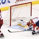 Arizona Coyotes' Justin Hodgman (12) celebrates his goal as Florida Panthers' Scottie Upshall, right, arrives late to defend and goalie Roberto Luongo slides on the ice during the third period of an NHL hockey game Saturday, Oct. 25, 2014, in Glendale, Ar