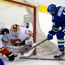 Canucks end 4-game skid with 2-1 win over Flames The Associated Press
