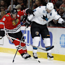 Chicago Blackhawks defenseman Duncan Keith (2) and San Jose Sharks left wing Patrick Marleau (12) maneuver with the puck behind the goal during the first period of the NHL hockey game on Sunday, Nov. 17, 2013, in Chicago The Associated Press