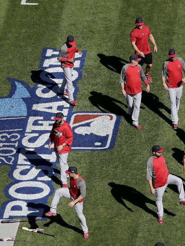 St. Louis Cardinals stretch during batting practice before Game 4 of the National League baseball championship series against the Los Angeles Dodgers, Tuesday, Oct. 15, 2013, in Los Angeles