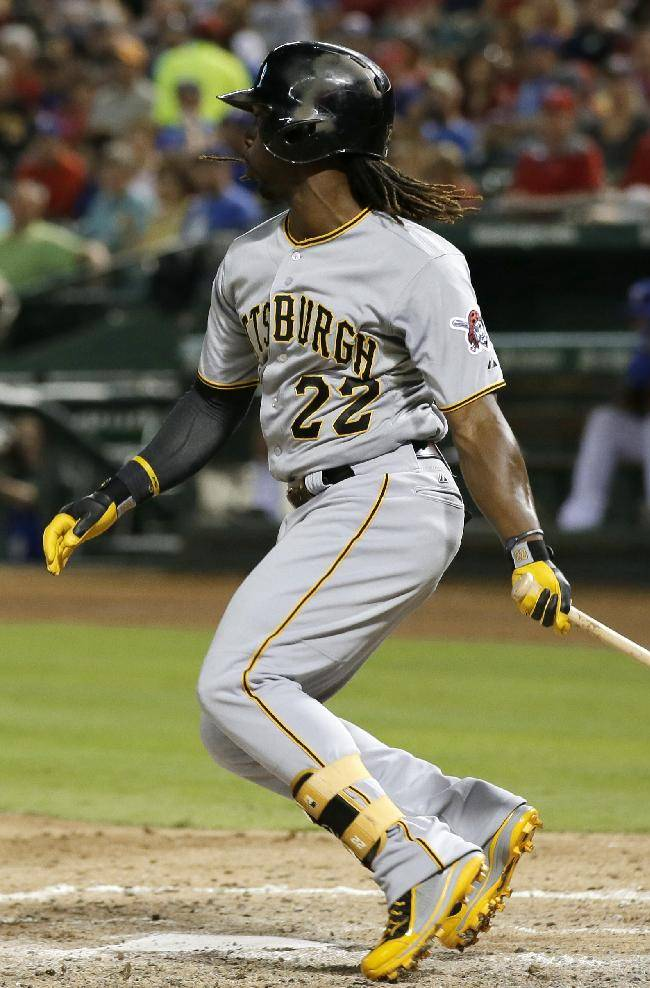 Pittsburgh Pirates' Andrew McCutchen (22) follows through on a run-scoring single off Texas Rangers' Martin Perez in the fifth inning of a baseball game, Tuesday, Sept. 10, 2013, in Arlington, Texas. McCutchen had three RBI singles as the Pirates won 5-4