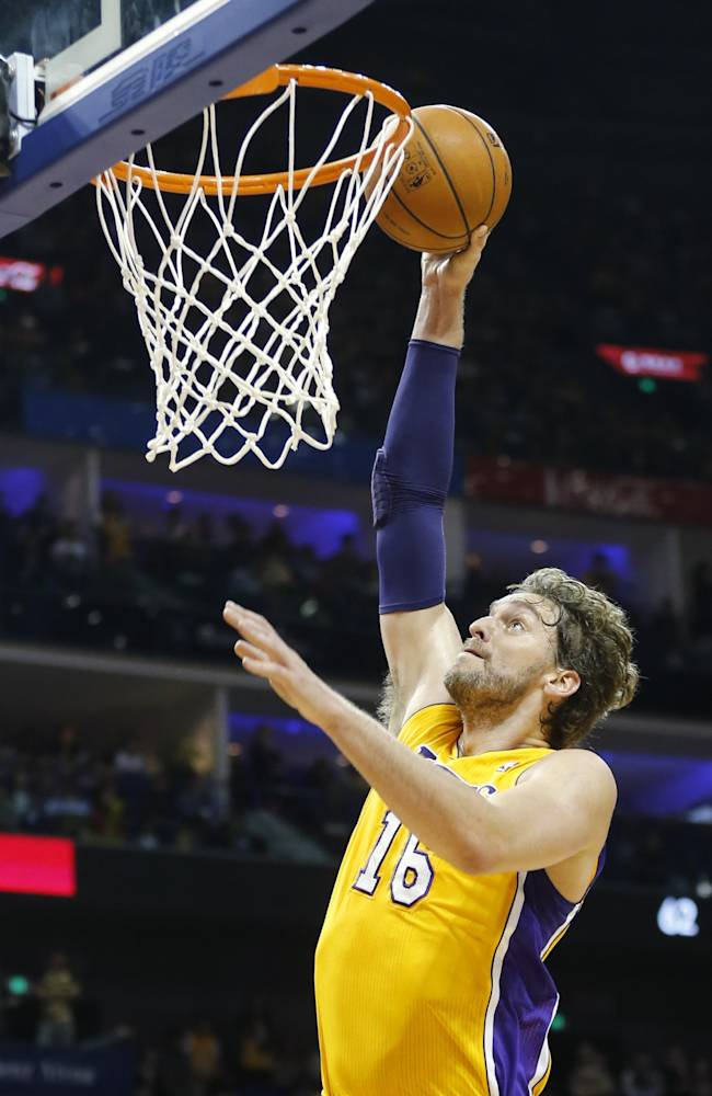 Pau Gasol of Los Angeles Lakers scores against Golden State Warriors during a 2013-2014 NBA preseason game between Lakers and Warriors at Mercedes-Benz Arena in  Shanghai, China, Friday, Oct. 18, 2013