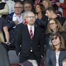 Manchester United's joint chairman Avram Glazer, center, takes his seat in the stands before the team's English Premier League soccer match against Swansea City at Old Trafford Stadium, Manchester, England, Saturday Aug. 16, 2014