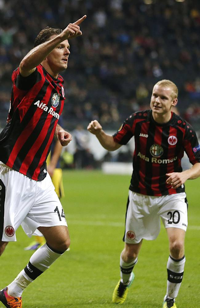 Frankfurt's Alexander Meier, left, celebrates his side's second goal during a Europa League group F soccer match between Eintracht Frankfurt and Maccabi Tel Aviv in Frankfurt,  Germany, Thursday, Oct.24, 2013