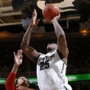 Michigan State's Derrick Nix (25) shoots against Nebraska's Shavon Shields (31) during the second half of an NCAA college basketball game, Sunday, Jan. 13, 2013, in East Lansing, Mich. Nix led Michigan State with 17 points in a 66-56 win. (AP Photo/Al Goldis)