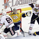 Nashville Predators goalie Pekka Rinne (35), of Finland, gloves a shot between Chicago Blackhawks' Andrew Shaw (65) and Jonathan Toews (19) in the final seconds of the third period of an NHL hockey game Thursday, Oct. 23, 2014, in Nashville, Tenn. The Pre
