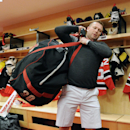 New Jersey Devils goaltender Martin Brodeur carries a bag into a back room as the NHL hockey team clean out lockers Monday, April 14, 2014, in Newark, N.J The Associated Press