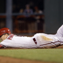 Arizona Diamondbacks' Cliff Pennington steals second base against the San Francisco Giants during the 10th inning of a baseball game on Thursday, April 10, 2014, in San Francisco. Pennington would then score the go-ahead run on a single by Tony Campana.