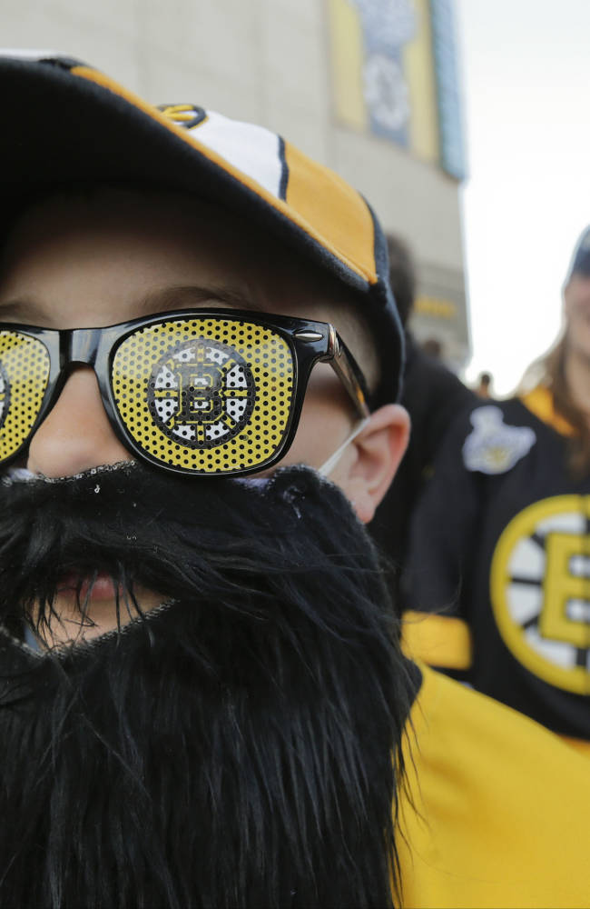 Dayton King of Langley, British Columbia, wears Boston Bruins glasses and a hockey playoff beard outside TD Garden before Game 4 of the NHL hockey Stanley Cup Finals between the Bruins and the Chicago Blackhawks in Boston, Wednesday, June 19, 2013