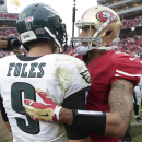 San Francisco 49ers quarterback Colin Kaepernick, right, greets Philadelphia Eagles quarterback Nick Foles (9) after an NFL football game in Santa Clara, Calif., Sunday, Sept. 28, 2014. The 49ers won 26-21. The Associated Press