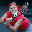 Petra Kvitova of the Czech Republic returns the ball against Venus Williams of the United States during their semi-final match of the Pan Pacific Open tennis tournament in Tokyo, Friday, Sept. 27, 2013. (AP Photo/Koji Sasahara)