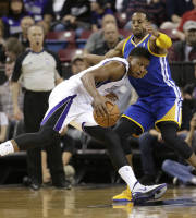 Golden State Warriors forward Andre Iguodala, right, blocks the drive of Sacramento Kings forward Rudy Gay during the first quarter of an NBA basketball game in Sacramento, Calif., Wednesday, Feb. 19, 2014. (AP Photo/Rich Pedroncelli0