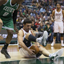 Milwaukee Bucks' Zaza Pachulia gets a hold of a loose ball as Boston Celtics' Jeff Green looks on during the second half of an NBA basketball game Saturday, Nov. 30, 2013, in Milwaukee The Associated Press