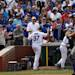 Chicago Cubs' Travis Wood tips his hat to the crowd after  his two run home run in the fifth inning against the New York Mets in the MLB National League baseball game in Chicago on Sunday, May 19, 2013