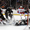 Anaheim Ducks goalie Frederik Andersen (31), of Denmark makes a save while on his back with Ducks center Saku Koivu, left, defenseman Ben Lovejoy (6) and defenseman Cam Fowler (4) looking on a shot by Carolina Hurricanes center Elias Lindholm, second from