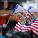 Supporters wave American flags and flags celebrating US skier Lindsey Vonn at the finish area after an alpine ski women's World Cup downhill in Val d'Isere, France, Saturday, Dec. 20, 2014. (AP Photo/Giovanni Auletta)