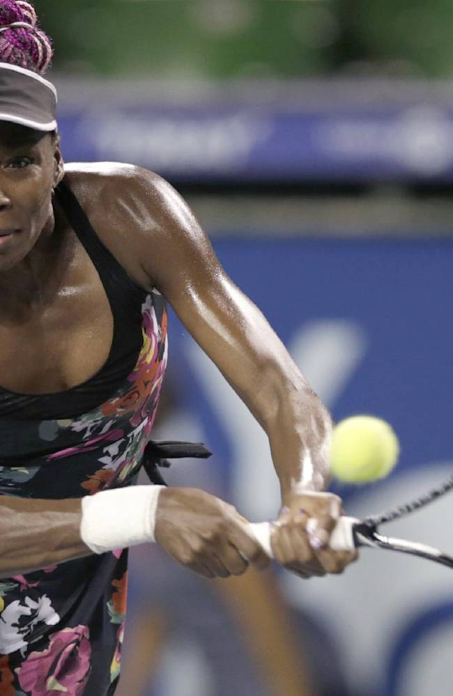 Venus Williams of the United States returns the ball against Victoria Azarenka of Belarus during their second round match of the Pan Pacific Open tennis tournament in Tokyo Tuesday, Sept. 24, 2013