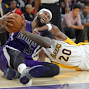 Sacramento Kings center DeMarcus Cousins, left, and Los Angeles Lakers guard Jodie Meeks battle for a loose ball during the second half of an NBA basketball game Sunday, Nov. 24, 2013, in Los Angeles The Associated Press