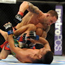 Jul 6, 2013; Las Vegas, NV, USA; Frankie Edgar and Charles Oliveira during their Featherweight Bout at the MGM Grand Garden Arena. (Jayne Kamin-Oncea-USA TODAY Sports)