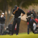 Tiger Woods reacts after hitting into a bunker from the 18th fairway on the first playoff hole during the final round of the Northwestern Mutual World Challenge golf tournament at Sherwood Country Club, Sunday, Dec. 8, 2013, in Thousand Oaks, Calif. (AP Photo/Mark J. Terrill)