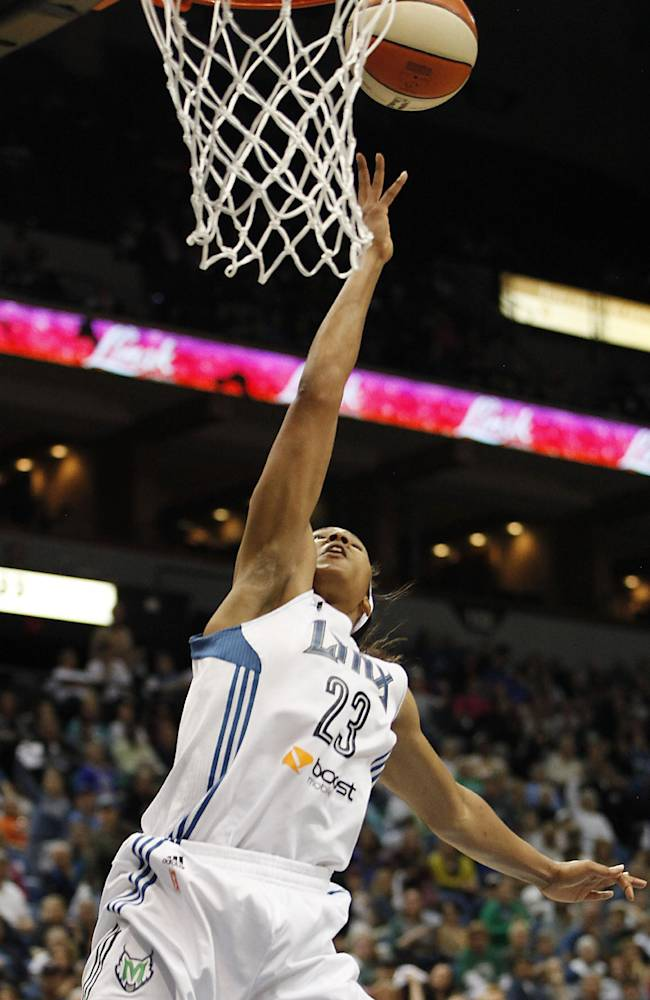 Minnesota Lynx forward Maya Moore (23) goes up to the basket against the Seattle Storm in the opening game of a first-round WNBA basketball playoff series, Friday, Sept. 20, 2013, in Minneapolis. The Lynx won 80-64