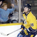 Nashville Predators left wing James Neal (18) skates back to the bench after scoring the winning goal during a shootout against the Los Angeles Kings at an NHL hockey game Tuesday, Nov. 25, 2014, in Nashville, Tenn. The Predators won the shootout to win the game 4-3. (AP Photo/Mark Humphrey)