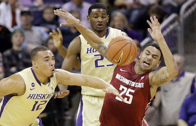 Washington's Andrew Andrews (12) knocks the ball away from Washington State's DaVonte Lacy (25) for a turnover in the first half of an NCAA college basketball game Friday, Feb. 28, 2014, in Seattle