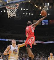 OAKLAND, CA - DECEMBER 13: James Harden #13 of the Houston Rockets dunks against David Lee #10 of the Golden State Warriors on December 13, 2013 at Oracle Arena in Oakland, California. (Photo by Rocky Widner/NBAE via Getty Images)