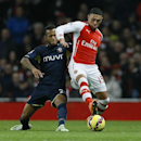 Arsenal's Alex Oxlade-Chamberlain, right, competes for the ball with Southampton's Ryan Bertrand during the English Premier League soccer match between Arsenal and Southampton at Emirates stadium in London, Wednesday, Dec. 3, 2014