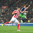 Stoke City's Ryan Shawcross, left, battles for the ball with Newcastle United's Jack Colback, during the English Premier League soccer match between Stoke City and Newcastle United, at the Britannia Stadium, in Stoke on Trent, England, Monday Sept. 29, 2