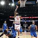 New York Knicks' Tyson Chandler (6) shoots against the Dallas Mavericks during the second half of an NBA basketball game, Monday, Feb. 24, 2014, in New York. Dallas won 110-108 The Associated Press