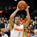 Syracuse's Michael Carter-Williams looks to pass against Central Connecticut State's Malcolm McMillan during the first half of an NCAA college basketball game in Syracuse, N.Y., Monday, Dec. 31, 2012. (AP Photo/Kevin Rivoli)