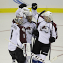Colorado Avalanche defenseman Brad Stuart, right, and center Marc-Andre Cliche, center, celebrate with goalie Semyon Varlamov after the Avalanche defeated the Los Angeles Kings 3-2 in a shootout during their NHL preseason hockey game Saturday, Oct. 4, 201