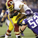 Washington Redskins wide receiver Pierre Garcon (88) tries to break a tackle by Minnesota Vikings outside linebacker Chad Greenway, right, after making a reception during the first half of an NFL football game Thursday, Nov. 7, 2013, in Minneapolis The As