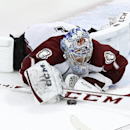 Colorado Avalanche goalie Semyon Varlamov (1) dives on a loose puck during the third period of an NHL hockey game against the Chicago Blackhawks Tuesday, March 4, 2014, in Chicago. The Avalanche won 4-2 The Associated Press