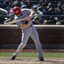 Cincinnati Reds' Ryan Ludwick hits an RBI-single during the sixth inning of a baseball game against the New York Mets at Citi Field, Sunday, April 6, 2014, in New York The Associated Press