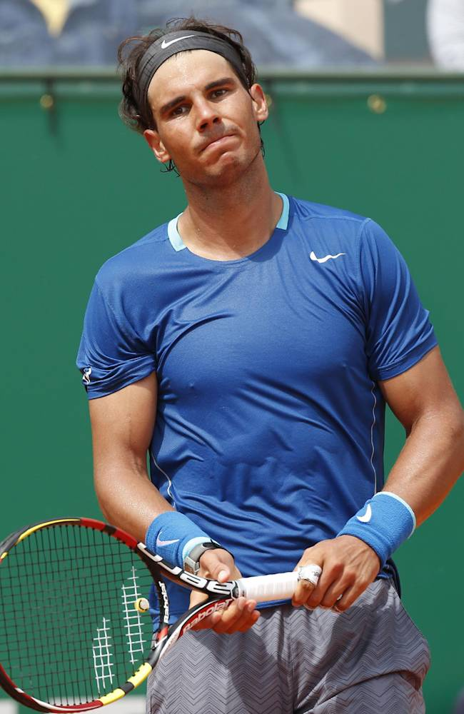 Rafael Nadal of Spain reacts after losing a point against David Ferrer of Spain during their quarterfinals match of the Monte Carlo Tennis Masters tournament in Monaco, Friday, April 18, 2014. Ferrer won 7-6 6-4