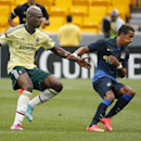 Milan forward Mario Balotelli, left, battles Manchester City midfielder Scott Sinclair during the second half of a soccer match in the first round of the Guinness International Champions Cup at Heinz Field on Sunday, July 27, 2014, in Pittsburgh. Manchest