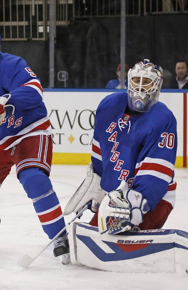 New York Rangers' Dan Girardi (5) defends as goalie Henrik Lundqvist (30), of Sweden, reacts while the puck sails past him as St. Louis Blues defenseman Kevin Shattenkirk broke a tie with his third-period goal in an NHL hockey game at Madison Square Garden in New York, Thursday, Jan. 23, 2014. The Blues defeated the Rangers 2-1