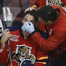 Florida Panthers trainer Dave Zenobi looks at Scottie Upshall after Washington Capitals' Mike Green was charged with boarding during the third period of an NHL hockey game, Thursday, Feb. 27, 2014, in Sunrise, Fla. The Capitals won 5-4 The Associated Pres