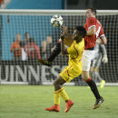 IMAGE DISTRIBUTED FOR GUINNESS INTERNATIONAL CHAMPIONS CUP - Liverpool's Raheem Sterling, left, battles for the ball against Manchester United's Phil Jones during the 2014 Guinness International Champions Cup Finals, on Monday, August 4, 2014 in Miami Gar